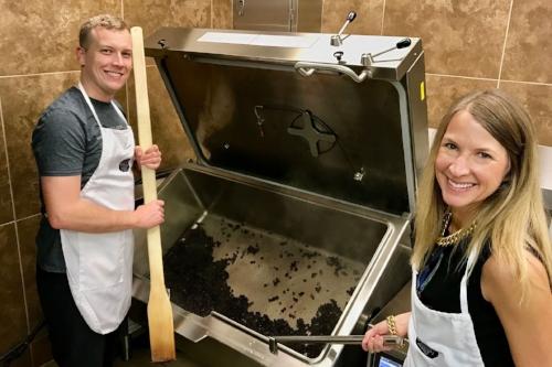 Two Chrane staff members use a commercial fryer in recipe development